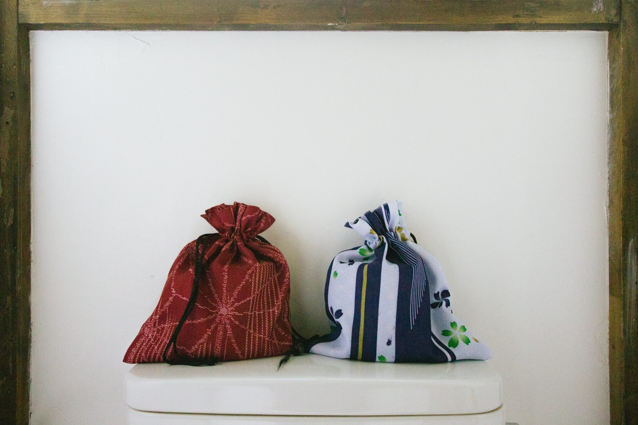 Toilet roll in their decorative sacks at coya cottage